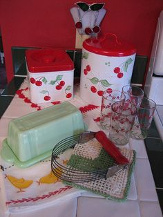 Love cherry motif kitchenware!  I have a set of canisters that looks a lot like this.