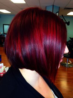 Red hair and sleek inverted bob! Hair by Dominae