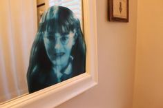 Moaning Myrtle on the bathroom mirror - Harry Potter party decoration idea