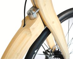 made entirely of bamboo, the prototype is a hybrid between bike and scooter which explores the changing behaviors associated with sustainable development. Wooden Bicycle, Wood Bike, Bicycle Pedals, Bicycle Parts, Char A Voile, Triumph Motorcycles, Mopar, Motorised Bike, Bike Builder