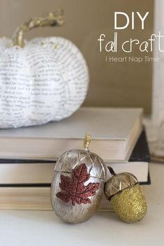DIY fall crafts... Book page pumpkins and glitter acorns