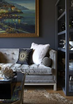 Adoring these deep, rich colors, and particularly loving the black upholstered chair! {via}