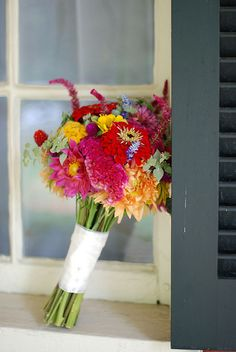 Combo of bright colors, both large and small flowers with some greens thrown in.