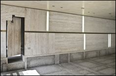 Lighting and concealed door integrated into wall paneling (Travertine?). Fondazione Querini Stampalia Carlo Scarpa (1953), Venice, Italy