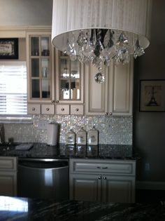 My new kitchen. Going with the Paris theme. Have 2 of these chandeliers over the island and love the mother of pearl backsplash.