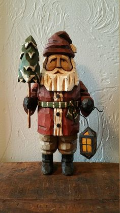 Tree Time Santa stands 10 1/2 inches tall and is hand carved from 3 thick basswood. He is hand painted, distressed and finished with close attention to every detail. Tree Time Santa will be a wonderful addition to your Christmas collection!! Allow 3-4 weeks for production of this finely crafted collectible.