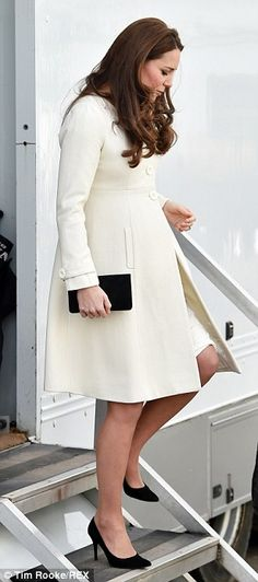 Careful now: The Duchess was forced to watch her step as she climbed out of the portakabin...