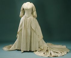 Courtesy of The Royal Armoury (http://emuseumplus.lsh.se/eMuseumPlus). Queen Fredrika's wedding dress, from 1797, originally had rims of silver lace, but these were removed in 1809 and used to decorate the coronation dress of Hedvig Elisabet Charlotta.