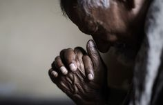 An elderly Pakistani Christian man, prays during a Mass on Good Friday in a church in Islamabad, Pakistan, Friday, March 29, 2013. Christians around the world are marking the Easter holy week.