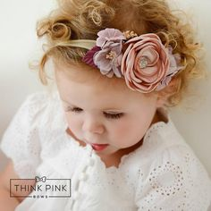 Her beauty will be in full bloom when she wears ourStunning Floral Headbands on Nylon! Designed to grow with your little one and perfect for girls of all ages! This headband features array flowers in a beautiful settingplaced on a skinny nylon headband that is so soft and stretchy and will not leave any marks on your babies head.This collection of Headbands is so playful and feminine. It is perfect to wear for any occasion, whether it be at a photo shoot, playing in the park, or an…