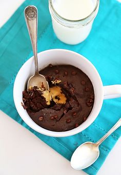 1-Minute Chocolate Peanut Butter Mug Cake - Fudgy, gooey eggless chocolate cake with molten peanut butter, baked in your microwave! | thecomfortofcooking.com