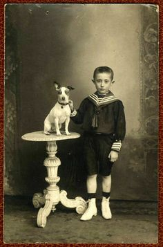 Portrait of a little boy with adorable dog on table.