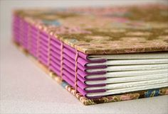 Coptic stitch. Use coloured paper to make a coloured spine, without making the signatures of coloured paper  by Zoopress studio, via Flickr