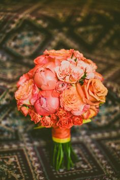 Gorgeous coral bouquet | Southern Elegance At This Sunset Inspired North Carolina Graylyn Estate Wedding | Photograph by Carolyn Scott Photography  http://storyboardwedding.com/southern-elegance-north-carolina-graylyn-estate-wedding