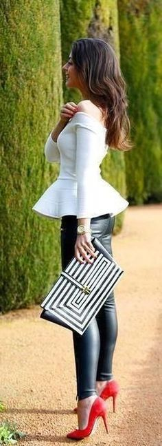 White peplum top with black leather look leggings and red suede pumps