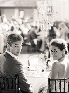Doesn't have to be at a table. Just with guests having a good time in the background. http://suziebrockmanphotography.com