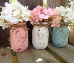 Distressed Mason Jar with flower arrangements. I have done a few of these and they are very pretty. I am SO obsessed with Mason Jar crafts right now!