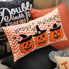 If you love traditional decor, then this Jack O' Lantern Happy Halloween Pillow is a perfect addition to your home. The orange and white chevron print and the embroidered jack-o-lanterns will complement the rest of your Halloween decor nicely!