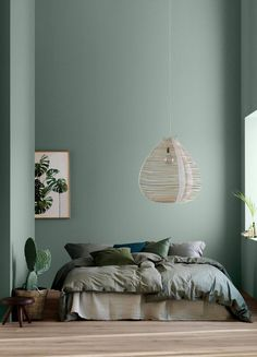 Modern Earthy Home Decor: Soothing bohemian bedroom with soft pistachio green blue walls and rattan hanging lamp | NONAGON.style #greenbedroom
