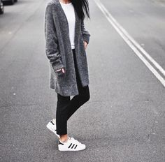 Grey cardigan + Adidas Superstar sneakers.