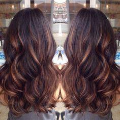 Golden carmel streaks on dark brown hair.