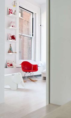 white kids room with a red accent