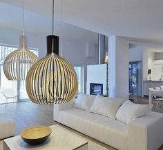 Admirable Family Room Interior Design with Big modern Pendant Lighting in Gold Color