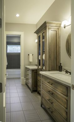 Lane Myers Construction Custom Home Builder Bathroom Tall Cabinet Gorgeous Flooring