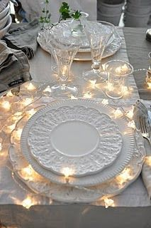 White lights with white on white table setting