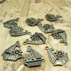 Take a look at these beautiful, classic sailboat or SailBoat with Wheel Charms.  You will receive 40 pieces.  These charms are made from a zinc