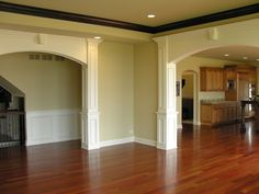 Love the archways, crown molding & waynescoating