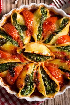 Recipe including course(s): Entrée; and ingredients: dried basil, fennel seeds, garlic, marinara sauce, parmesan cheese, pasta shells, pepper, ricotta cheese, salt, spinach