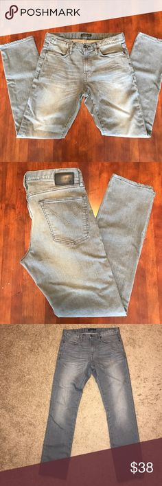 Men's Distressed Gray John Varvatos Star USA Jeans Great condition men's designer John Varvatos star USA jeans in a beautiful gray color with distressed detailing on front and back. The cut is slim straight and the waist size is 31. They are in near perfect condition with only one tiny little rough spot near back left pocket as shown in photo that looks like it is part of the distressed detail overall. Hardly worn and they look great! John Varvatos Jeans Slim Straight