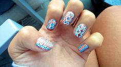 I did this by painting my nails white and then using a red and blue nail pen to draw intricate designs for fourth of july