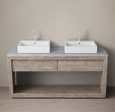 RH's Reclaimed Russian Oak Double Washstand - Deck Mount:Handcrafted of solid reclaimed oak timbers from decades-old buildings in Russia, our bath furniture is simple and functional in design. A salute to clean and contemporary style, each piece celebrates the beauty of unadorned salvaged Russian oak. The high-fired ceramic vessel basins are crafted in Germany by Duravit.SHOP THE ENTIRE COLLECTION ▸ $3446