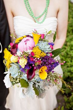 """They wanted their wedding to be """"... bright, fun and colourful"""" Mission complete! The bouquet says it all. See more here: http://www.StyleMePretty.com/canada-weddings/2014/05/22/colorful-diy-halifax-seaport-wedding/ Photography: KandiseBrown.com"""