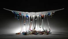 "Artist Daniela Forti lives and works in Chianti, Tuscany where she produces these fantastic artworks of dripped glass. She refers to the pieces as ""Jellyfish"" because of their undulating tentacles that are formed by hand through a melted glass fusion process. Each piece appears to balance like a sma"