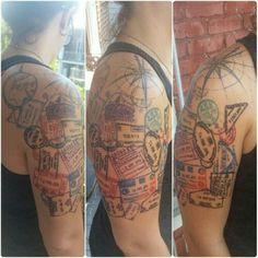 Wanderlust watercolor tattoo