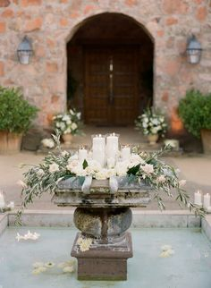 Olive floral and candle decorated fountain