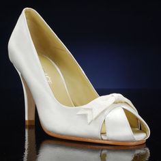 CHELSEA by GRACE Bridal and Bridesmaid Shoes These would also look cute in red...almost a peep-toe but not really.