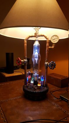 Hey, I found this really awesome Etsy listing at https://www.etsy.com/listing/484386156/illuminated-mad-scientist-steampunk-lamp