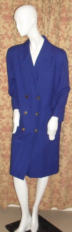 Check out this item in my Etsy shop https://www.etsy.com/uk/listing/249960640/1980s-electric-blue-wool-coat