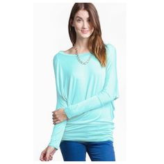 Soft Mint Green Jersey Dolman Long Sleeve Top The most comfortable top you will own. This is a Mint Green dolman style jersey knit top with long sleeves. Perfect with jeans or leggings or even a pair of pj pants to snuggle up in.made of 95% rayon 5% spandex Made in the USA Love In Tops Tees - Long Sleeve