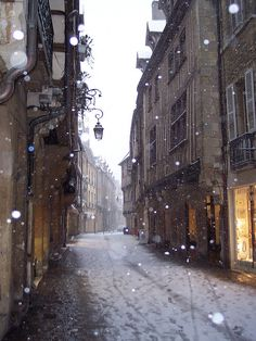 Snow falling on the Rue Verrerie, Dijon, France. This is one of the pedestrian streets and the most picturesque shopping and historic center of Dijon, largely occupied by antique dealers. Oh The Places You'll Go, Places To Travel, Places To Visit, Beautiful World, Beautiful Places, Beautiful Streets, Petite France, Snow Pictures, Ville France