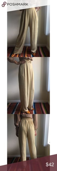 """Vintage✨crepe wide leg knot waist trousers Super unique yet minimal. Crepe textured trousers with knot closure waist, super high rise, and wide relaxed leg. 100% rayon in a lovely vanilla color. Marked vintage 10, works for a variety of sizes due to elastic waist. Measurements flat: waist 13-16"""", rise 17"""" (woah!!!), hip 22"""", inseam 30.5"""". Seen on 5'6"""" 26"""" waist model wearing approx 2 inch heels. Made in USA, Componix brand. Vintage Pants Wide Leg"""
