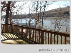 Beautiful View, from this lakefront cabin on 2 Acres with 220 feet of Lakefront! Home needs updating, but you will love the popular Y Rd. location. In an area of very nice homes. Come take a look, this property has lots of potential in Linn Creek MO