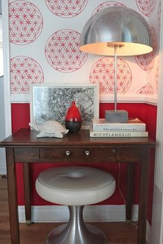 Emily Henderson - silver mushroom table lamp pops off of the red/white wallpaper beautifully