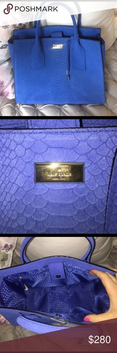 Kate Spade Blue Snakeskin Purse This is an adorable authentic Kate Spade Elsie Exotic Large Meriwether bag. It has a snakeskin pattern. It's a gorgeous cobalt blue and feels like suede. Large bag with plenty of room. Worn once, I love this purse but I'm trying to downsize. kate spade Bags Totes