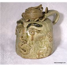 "This whimsical ""Church Lady"" Face Jug is an original piece of Alabama folk art from TRIP (Tennessee River Inspirational Pottery).  Face jugs have a long tradition in the American South - slaves made them to put on graves, and they are often grotesque or frightening.    TRIP face jugs are different - they are often whimsical, and they are inspirational as well as decorative.    #primitive #country #decor"