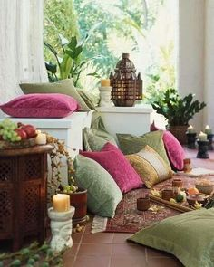 Love all the pillows, patterns and bold colors my patio has lots of pillows and colors with lanterns and bright Indian and Asian decor also.